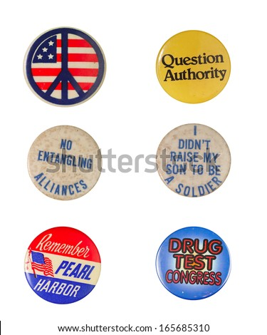 Array of vintage political & patriotic buttons: Peace symbol with US flag, Question Authority, No Entangling Alliances, I Didn't Raise My Son to be a Soldier, Remember Pearl Harbor, Drug Test Congress