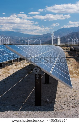 Arrays of solar panels and rows of wind turbines capture energy