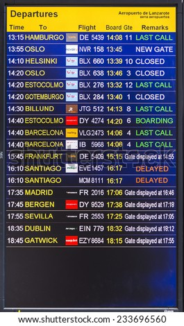 ARRECIFE, SPAIN - NOV 21, 2014: flight information display screen board at airport of Arrecife, Spain.  In 1999 a new passenger terminal opened with a capacity of 6 million passengers per annum. - stock photo