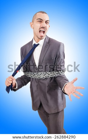 Arrested businessman in studio shooting - stock photo