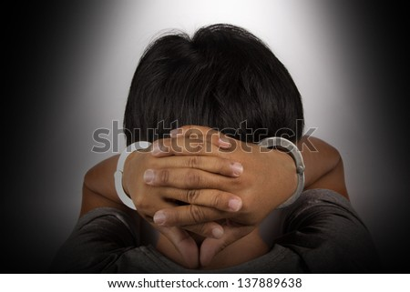 Arrested man handcuffed - stock photo