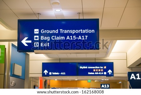 arrival and departure gates signs - stock photo