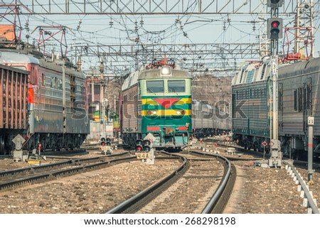 Arrival and departure of the passenger trains at day time. - stock photo