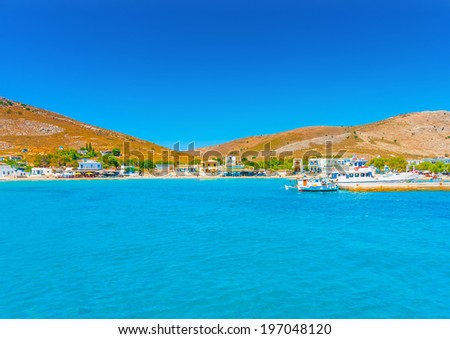 arrival at Pserimos pictorial island in Greece - stock photo
