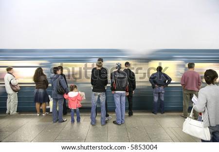 arrival of subway train - stock photo