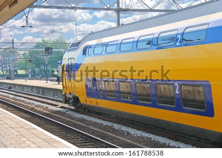 Arrival of the train at railway station - stock photo