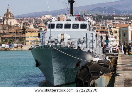 Arrived in the port of Catania on patrol Denaro Finance Guard carrying 220 migrants including 5 women.The immigrants were rescued about forty miles north of Libya. - stock photo
