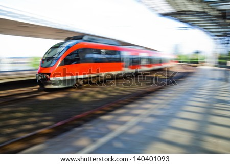 arriving train in a railway station with intentional motion blur