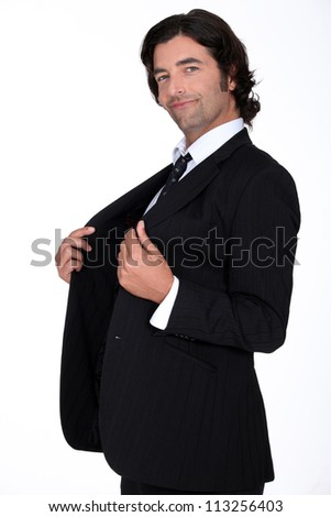 Arrogant man wearing suit