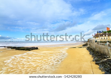 Arromanches les Bains, seafront beach and remains of the artificial harbour, used on D-Day in World War II. Normandy, France. - stock photo