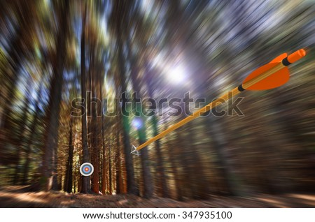 Arrow flying to target with radial motion blur - stock photo