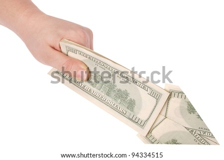 Arrow in a hand made of dollars isolated on white