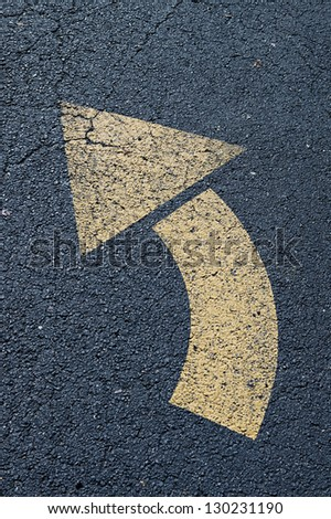 Arrow left turn sign on the road