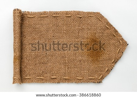 Arrow made from a burlap with wrapped edges on a white background. - stock photo