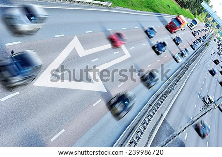 Arrow. Motion blurred daytime traffic - stock photo