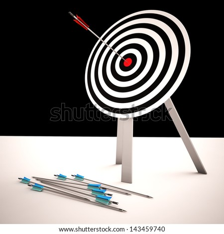 Arrow On Dartboard Shows Centered Shot Or Accurate Aim - stock photo