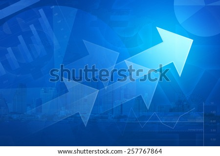 Arrow on financial graph chart and city tower for business background - stock photo