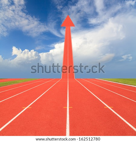 Arrow on running track, the concept of running and competing for success - stock photo