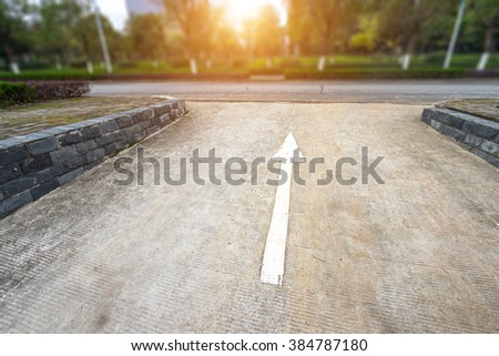 Arrow on the road - stock photo