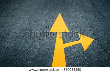 Arrow on the road, yellow
