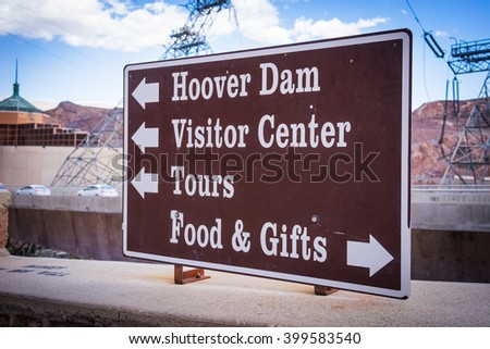 Arrow points directions to tourists and visitors at the Hoover Dam location in the American southwest. - stock photo