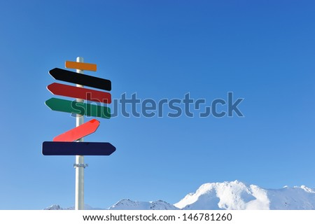 Arrow sign at mountains with snow in winter, Val-d'Isere, Alps, France - stock photo