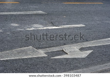 arrow sign on surface of street