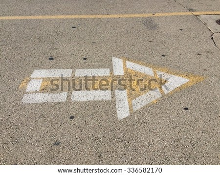 Arrow sign on the road to go toward right - stock photo