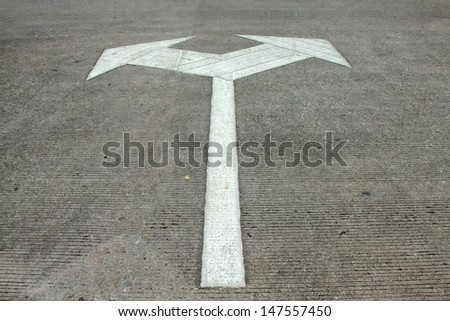 Arrow sign on the way.Direction sign for driver. - stock photo