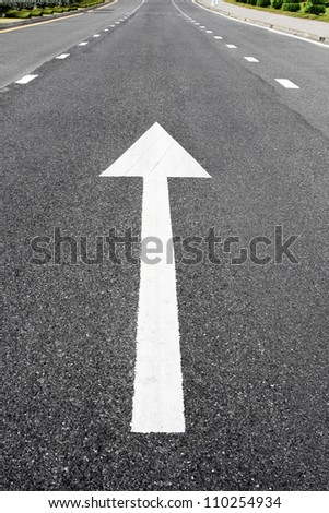 Arrow signs as road markings on a street - stock photo