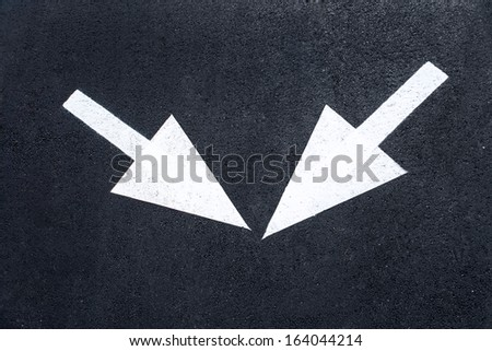 Arrow signs as road markings / photography of road markings and traffic symbol on surface road  - stock photo