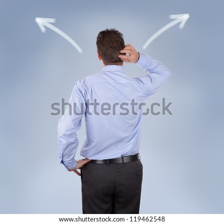 Arrow signs showing two different directions with a businessman scratching his head concept for confusion, choice and decisions - stock photo