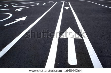 Arrow traffic on the asphalt road / photography of road markings and traffic symbol on surface road  - stock photo