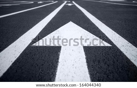 Arrow traffic signs / photography of road markings and traffic symbol on surface road  - stock photo
