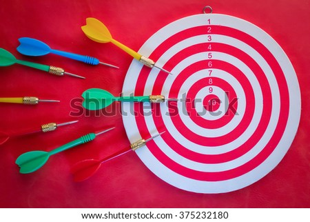 Arrows dart hitting the center of a target view from top, success business concept - stock photo