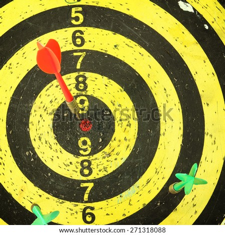 arrows darts hit the target on a  background - stock photo