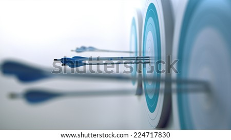 Arrows hit targets. - stock photo
