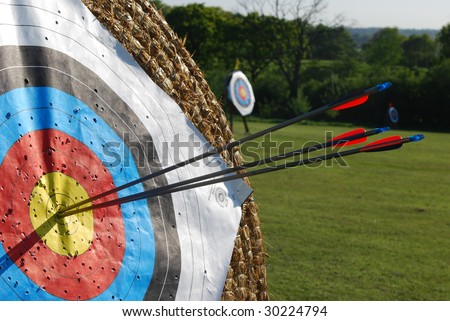 Arrows in center of target - stock photo
