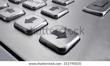 arrows key ,stainless keyboard close up - stock photo