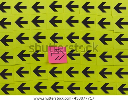 Arrows. Opposite concept. Background of green sticky notes.