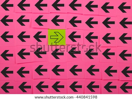 Arrows. Opposite concept. Background of pink sticky notes.