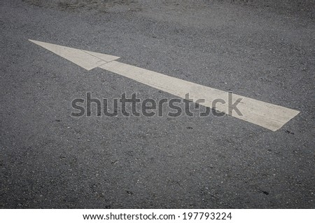 Arrows, the road as background - stock photo