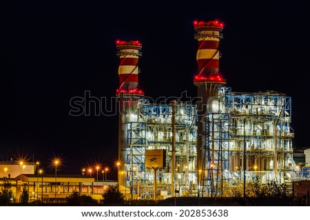 Arrubal, Spain - June 21, 2014: ContourGlobal's combined cycle power plant at night in Arrubal, La Rioja, Spain. Built by Siemens, it has two groups of 400MW. ContourGlobal is a New York based company - stock photo
