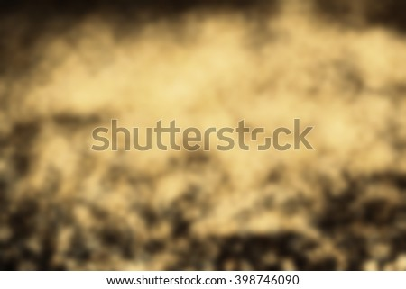 Art abstract glitter background with blinking lights and gold defocused texture. Dark Golden festive bokeh - stock photo