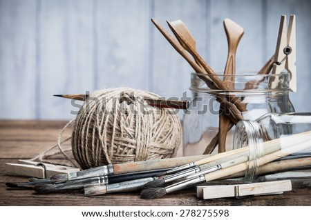 Art and craft tools set. Grunge wooden background. - stock photo