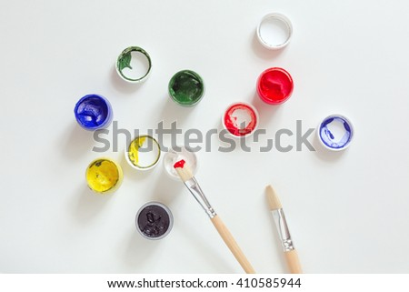 Art and Creation Concept Set of color Paints and wooden Brush on white Table - stock photo