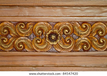 Art carved on wood. - stock photo