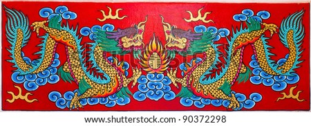 Art Chinese style painting two dragon on wall in temple.Generality in Thailand, any kind of art decorated in Buddhist church etc. created with money donated by people, no restrict in copy or use. - stock photo