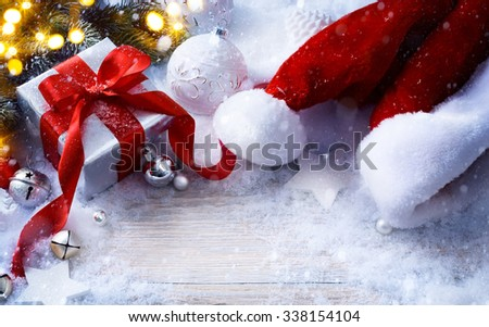 art Christmas festive background with Christmas balls and gift box - stock photo