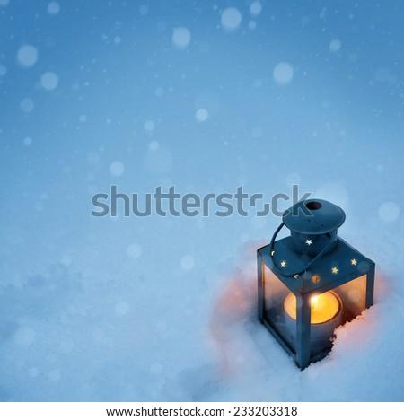 art Christmas lantern with snowfall - stock photo